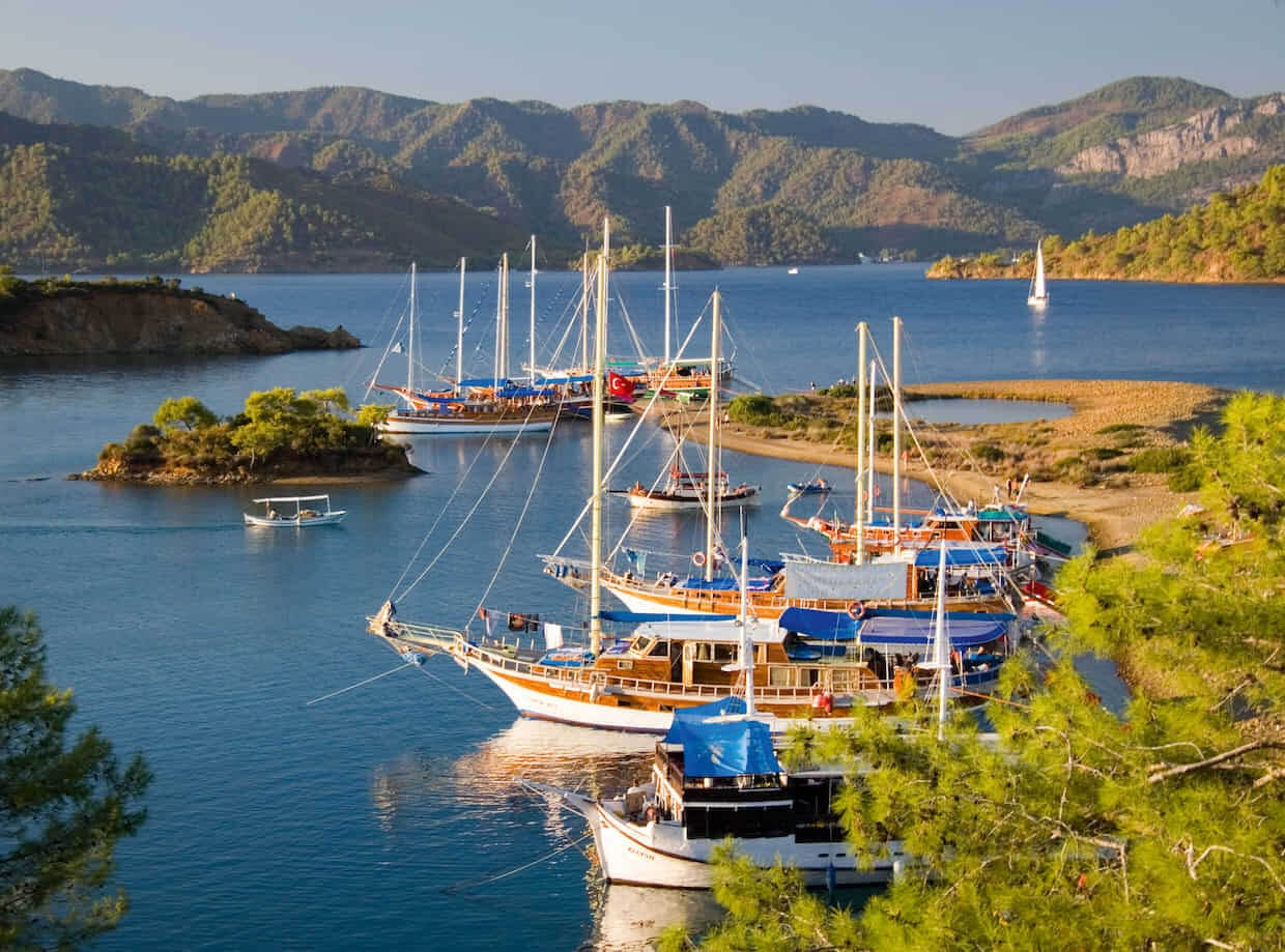 A74MN0 Gulets in harbor with mountains near Fethiye Turkey